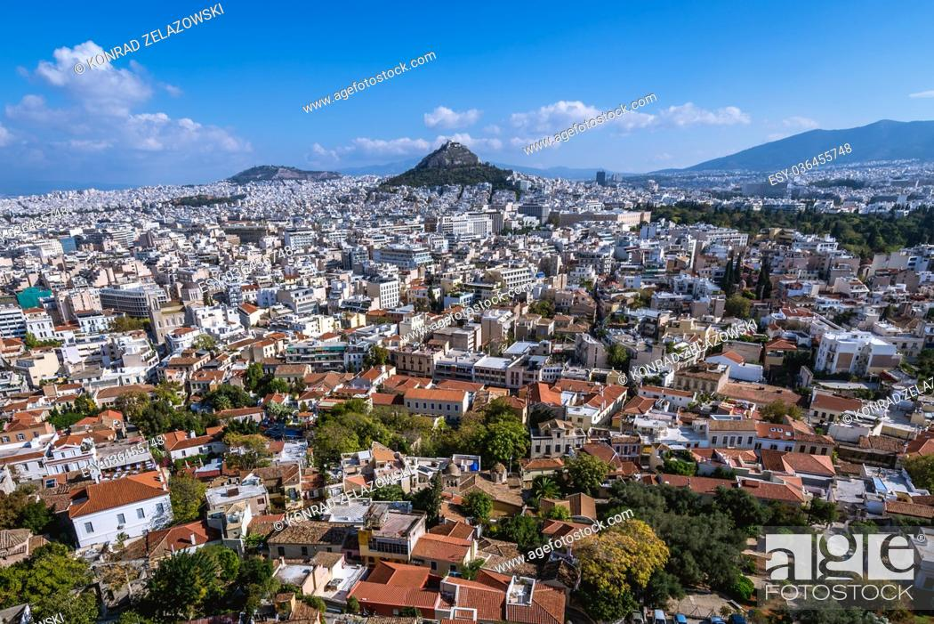 Stock Photo: Aerial view from Acropolis of Athens city on Plaka historical district, Greece. Mount Lycabettus seen on photo.