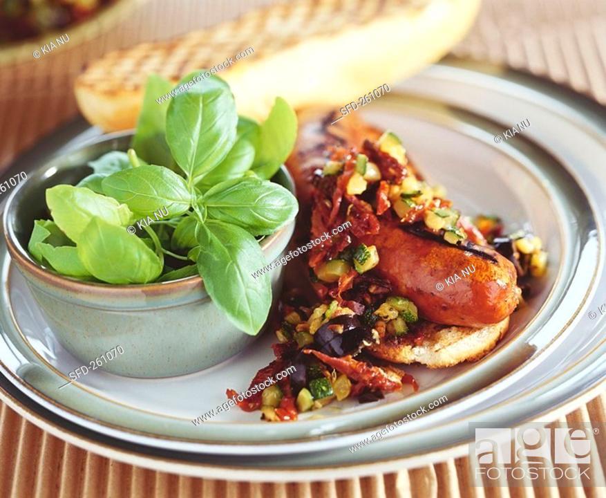 Stock Photo: Salsiccia con salsa di verdure sausage with vegetable sauce.