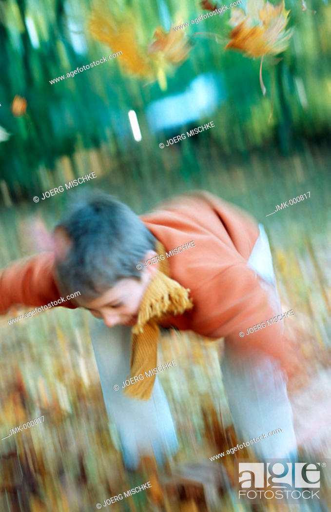 Stock Photo: Little boy in the autumnal wood, forest, jumping.