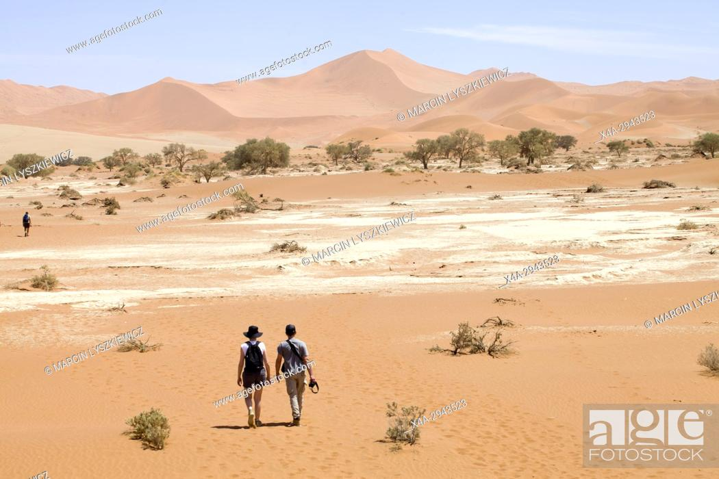 Stock Photo: A young couple walking on the desert.