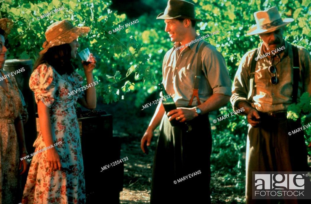 Stock Photo: Aitana Sanchez-Gijon, Keanu Reeves & Giancarlo Giannini Characters: Victoria Aragon, Paul Sutton & Alberto Aragon Film: A Walk In The Clouds (1995) Director:.