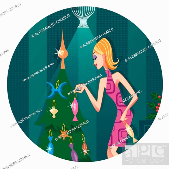 Stock Photo: A Pisces woman hanging ornaments on a Christmas tree.