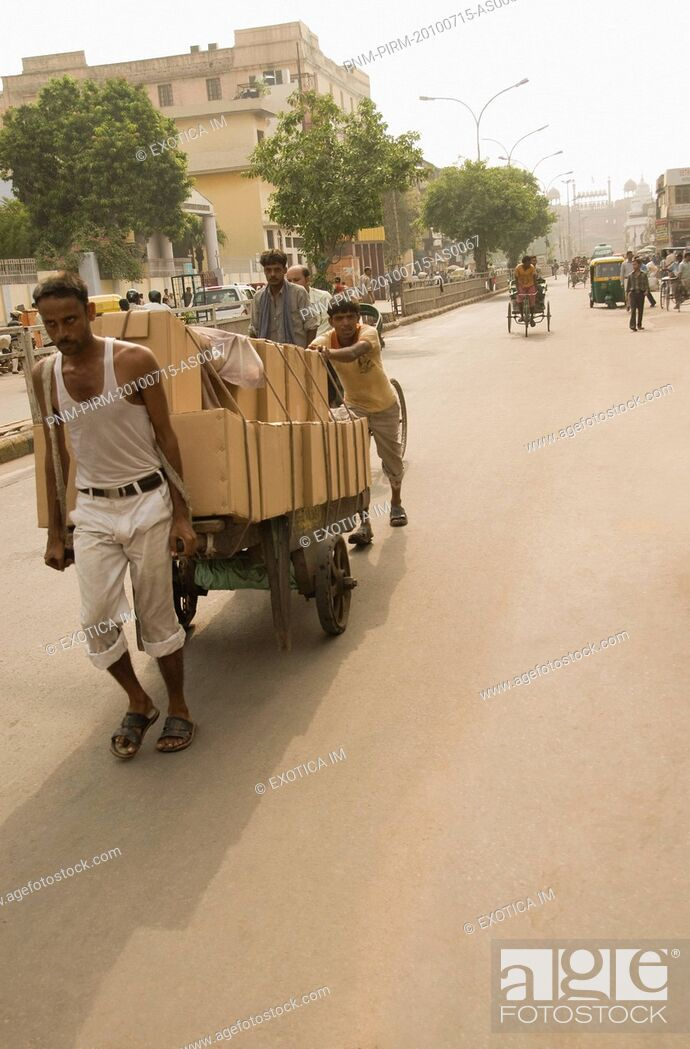 Stock Photo: Workers pulling a cart on the road, Chandni Chowk, Delhi, India.