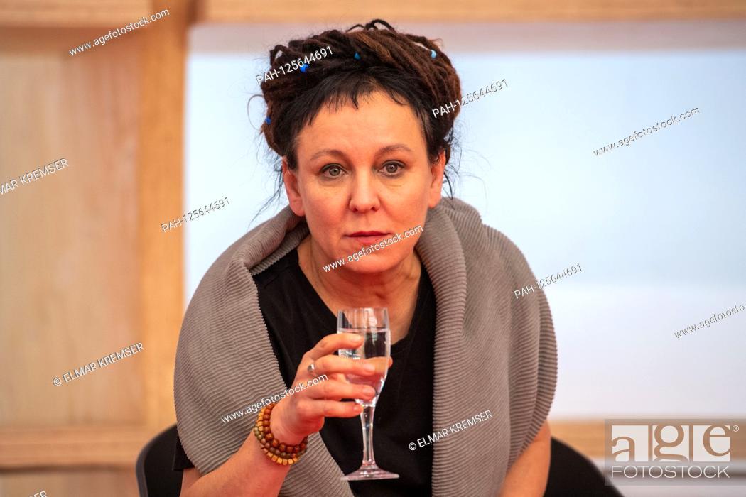 Stock Photo: Olga TOKARCZUK, Literaturnobelpreistraegerin 2018, drinks water, drinking, Brustbild, during the opening press conference for the Frankfurt Book Fair 2019 on 15.
