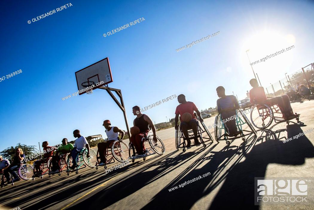 Stock Photo: Players of Wheel-Ability Sports Club basketball team have their training in Katutura, Windhoek, Namibia. Every Sunday they invite people from the Windhoek.
