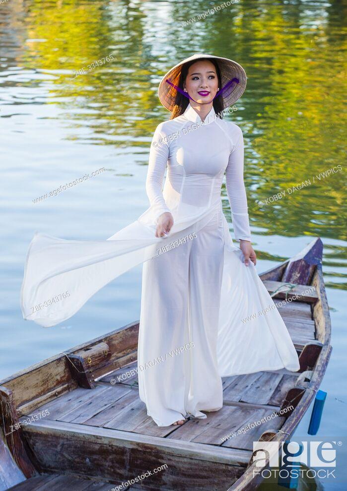 Stock Photo: Vietnamese woman wearing Ao Dai dress during the Mid autumn festiaval in Hoi An Vietnam.