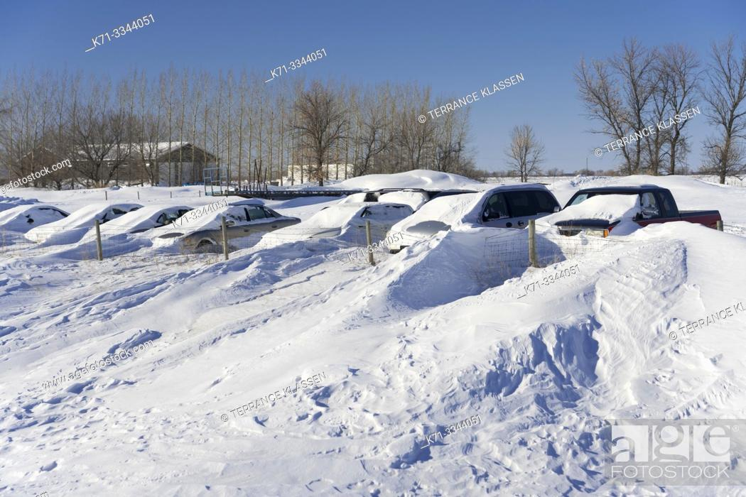 Stock Photo: Parked vehicles and snow drifts near Gnadenthal, Manitoba, Canada.