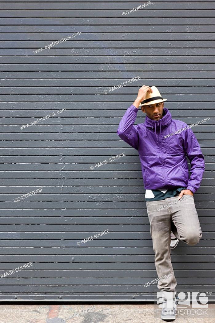 Stock Photo: Man wearing fedora.
