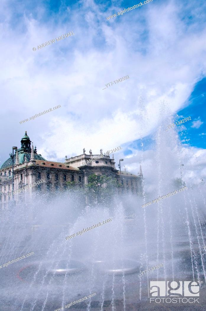 Stock Photo: Karlsplatz Stachus fountain with the Palace of Justice, Munich, Germany.