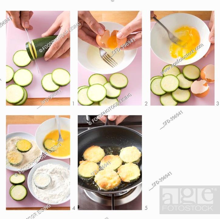 Stock Photo: Preparing breaded courgette slices.