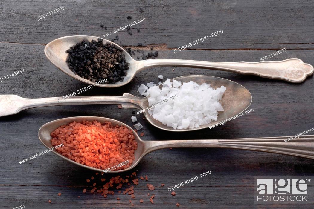 Stock Photo: Three types of salt on silver spoons.