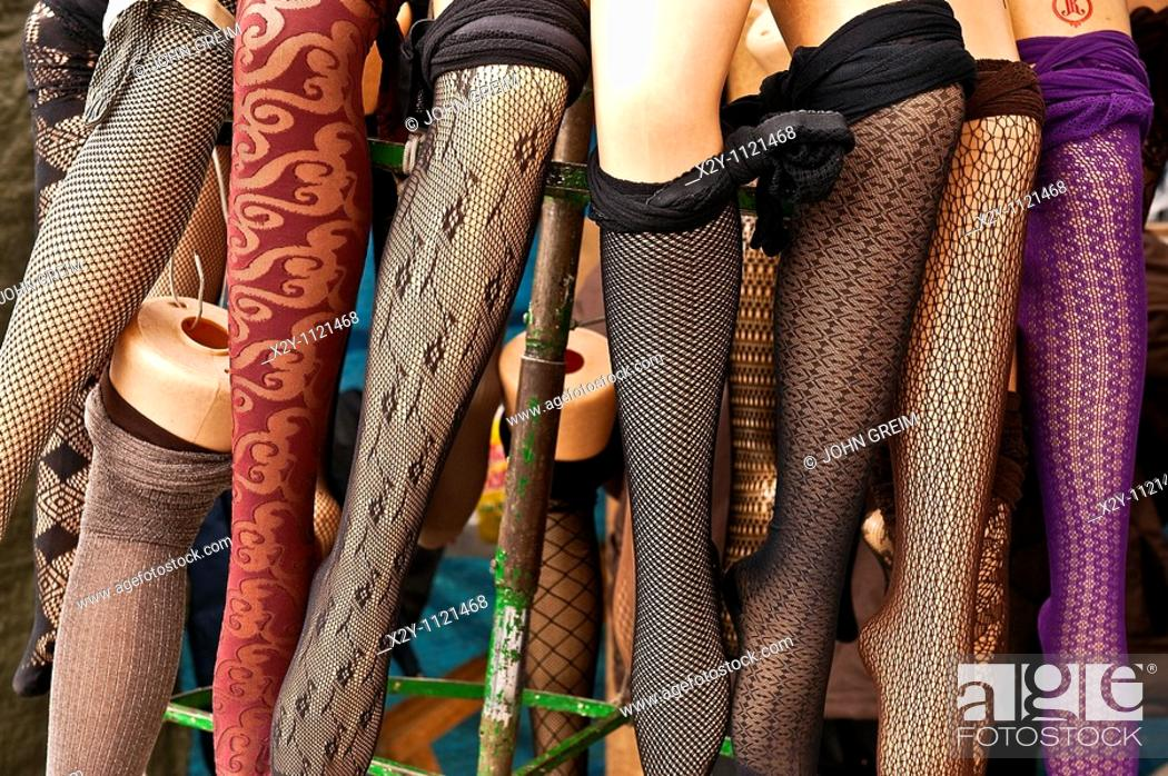 Stock Photo: Mannequin legs model stockings in an outdoor market.