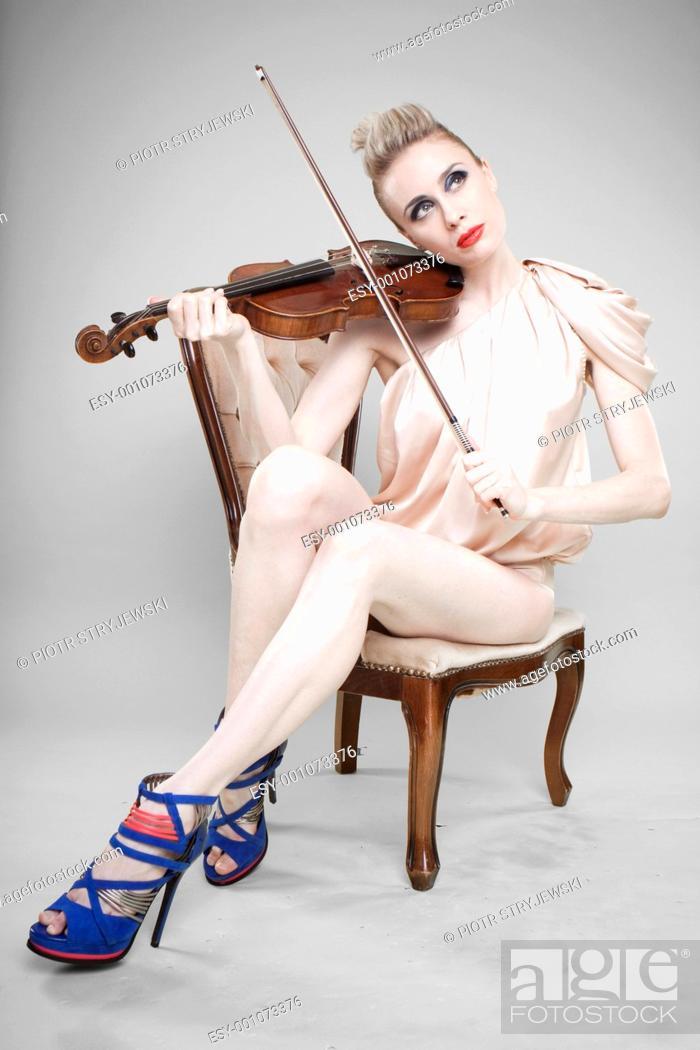 Stock Photo: Glamorous woman with violin.