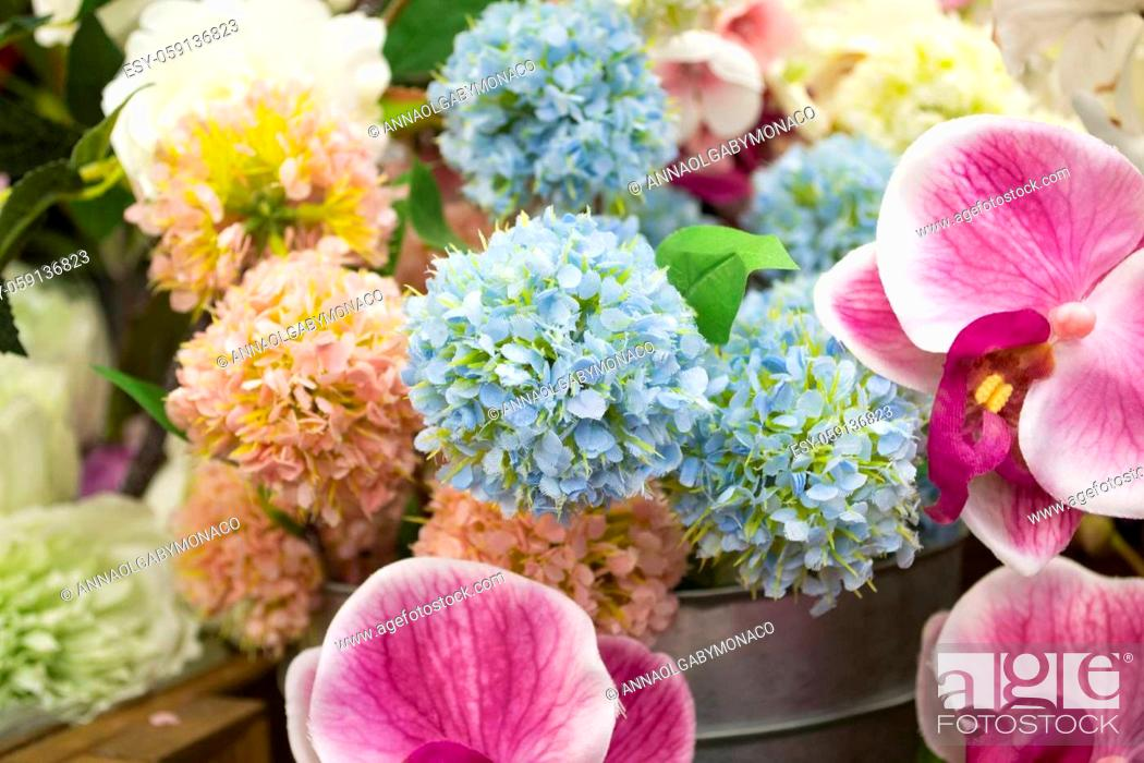Stock Photo: Colorful vintage decoration artificial flower near sunlight close up.