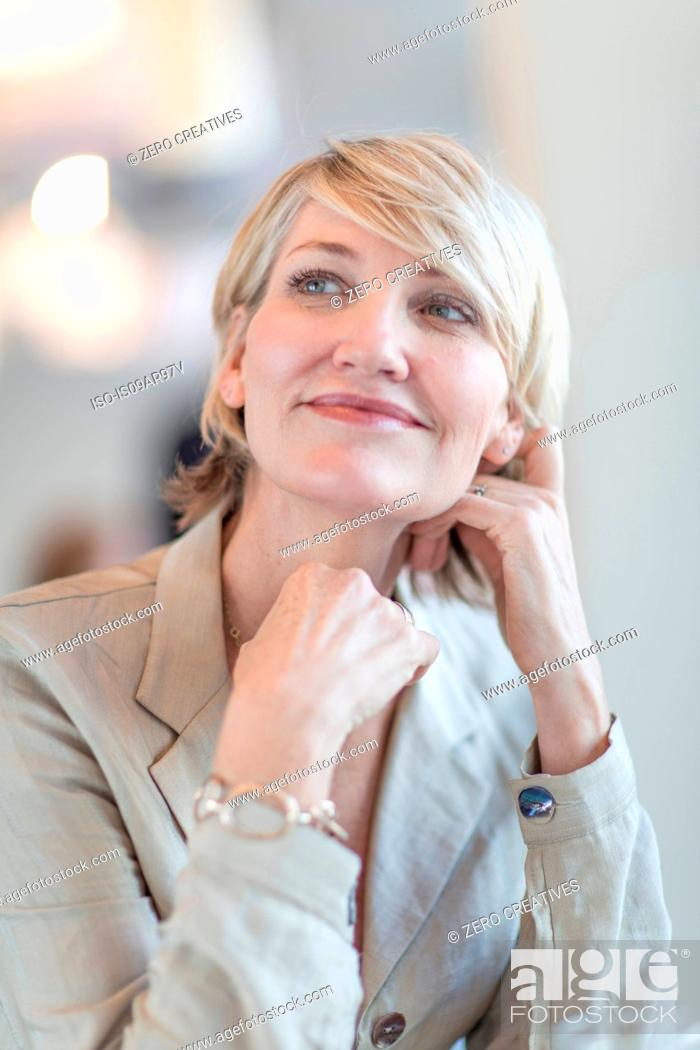 Stock Photo: Portrait of mature businesswoman looking up.