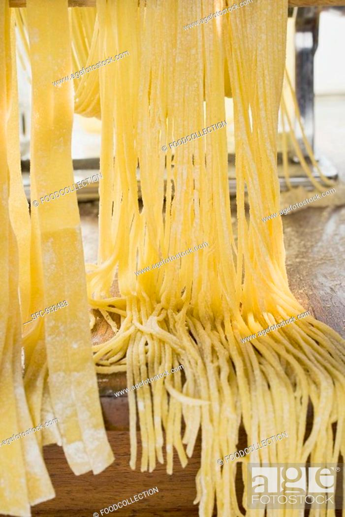 Stock Photo: Home-made pasta with pasta maker.