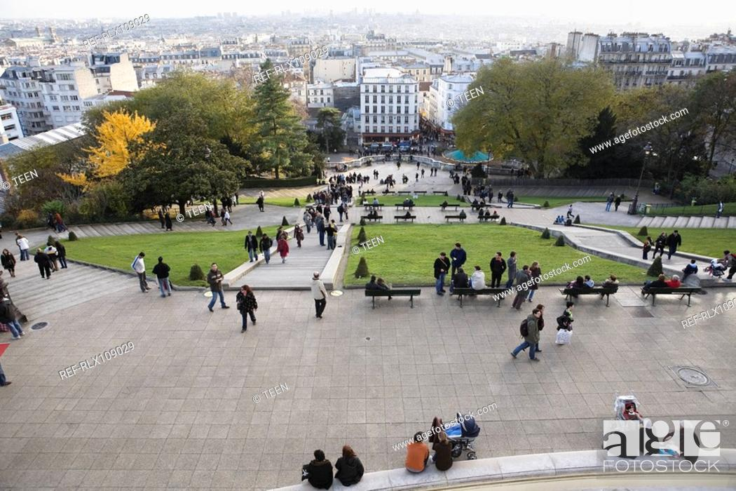 Stock Photo: Tourists in gardens below Sacre Coeur, Montmartre, Paris, France.