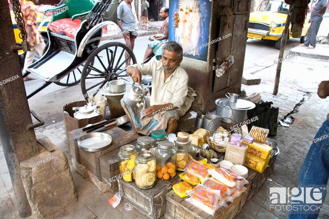 Stock Photo: Teashop on street , Calcutta now Kolkata , West Bengal , India.