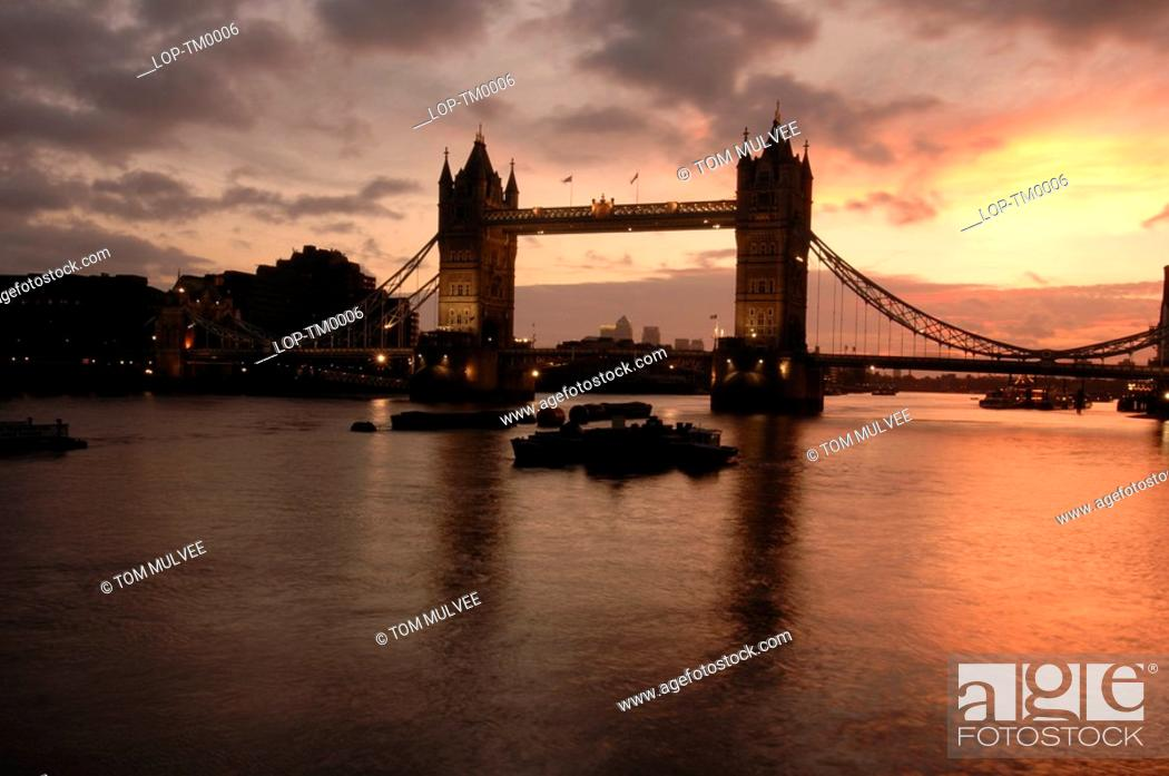 Stock Photo: England, London, Tower Bridge, Tower bridge at dawn with Canary Wharf behind. The bridge was opened on 30 June 1894 by the Prince of Wales.