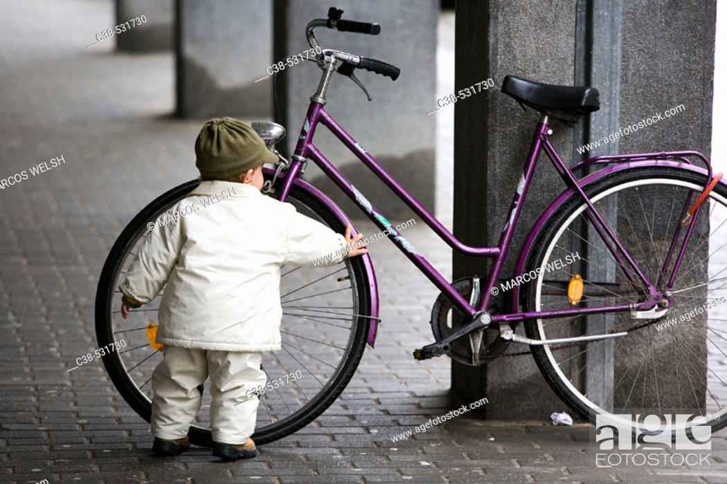 Stock Photo: Boy Discovers a Bicycle in Maribor, Slovenia.