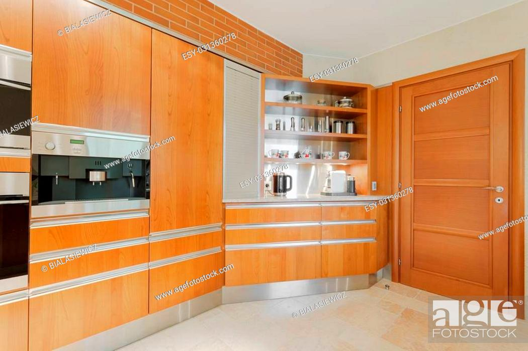 Stock Photo: Horizontal image of well equipped modern kitchen in wood.