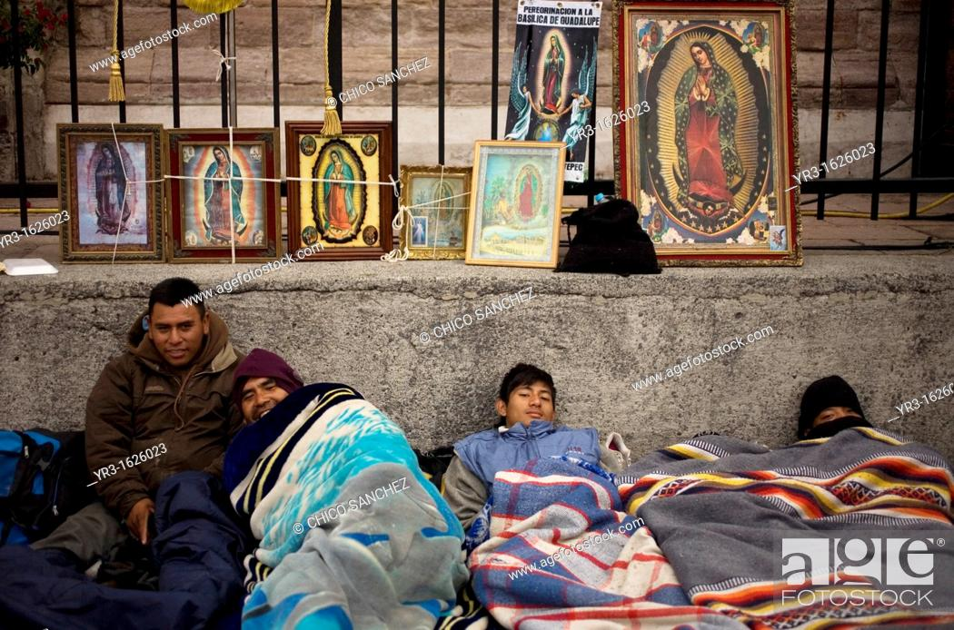 Stock Photo: Pilgrims sleep by an image of the Our Lady of Guadalupe virgin in Mexico City, December 11, 2012  Hundreds of thousands of Mexican pilgrims converged on the Our.