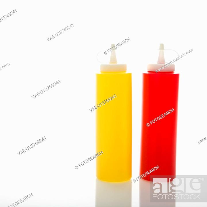 Stock Photo: Plastic ketchup and mustard containers.