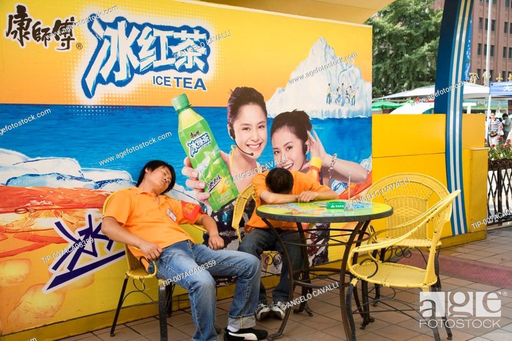 Stock Photo: China, Beijing, Wangfunjing Road,man sleeping on a table.