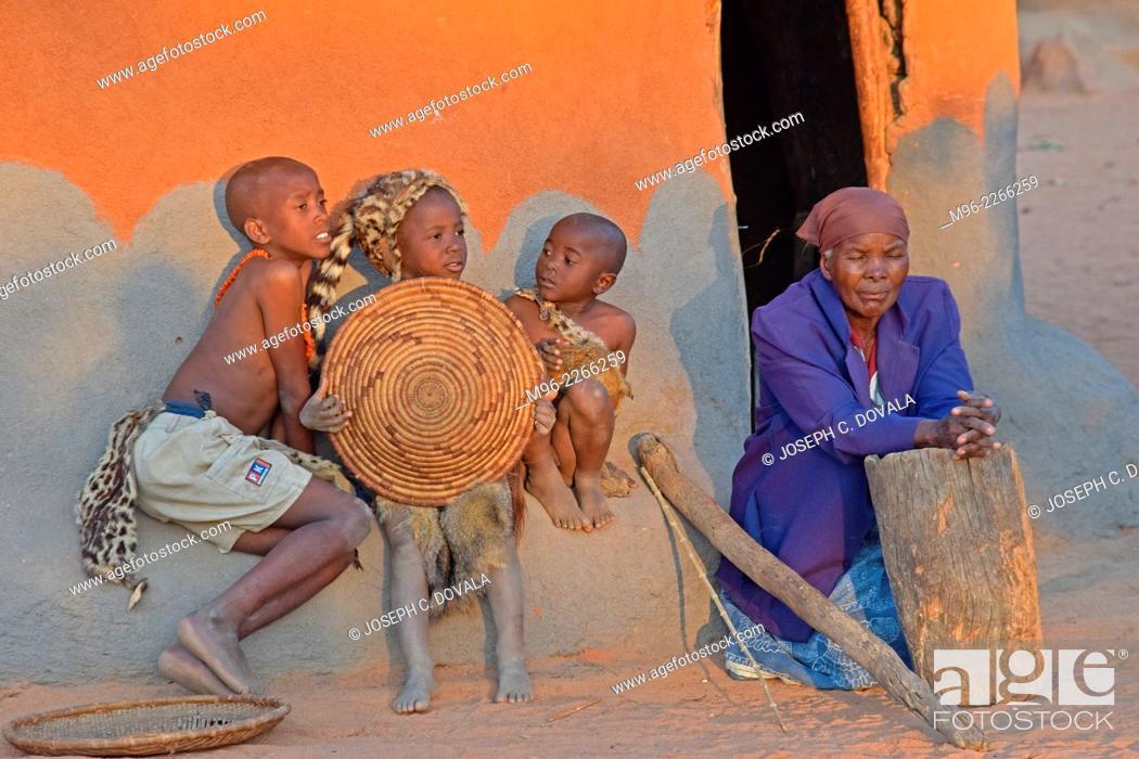 Stock Photo: Local village children and elderly woman, Matopos, Zimbabwe, Africa.
