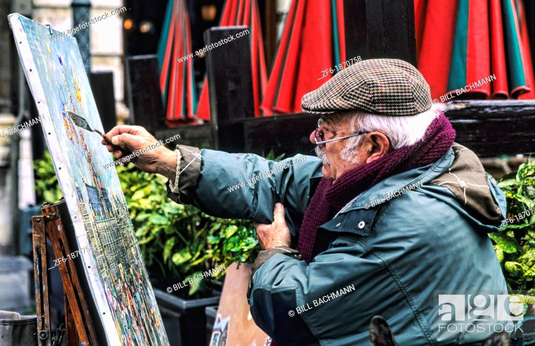 Stock Photo: An artist painting painting in the beautiful Grand Place square with 16th Century buildings in Brussels Belgium Europe.