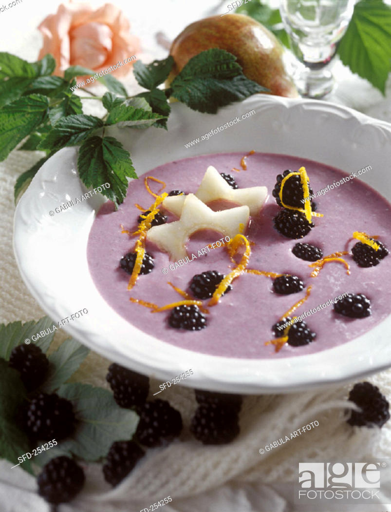 Stock Photo: Cold blackberry soup with pear slices.