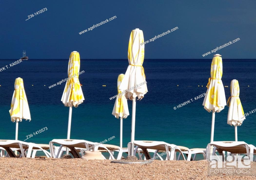 Stock Photo: Umbrellas at Croatia's most famous beach The Golden Horn Zlatni Rat near Bol on the Island of Brac, Croatia.
