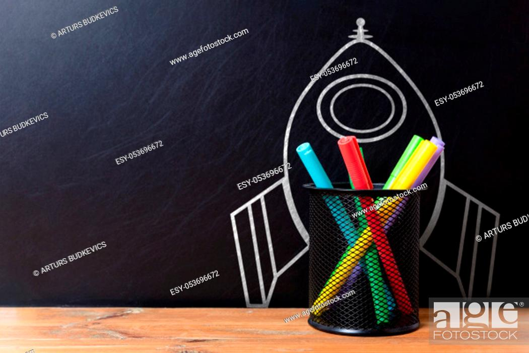 Stock Photo: School stationery supplies and hand drawn rocket ship on dark background. Back to school concept. New idea and creativity launching.