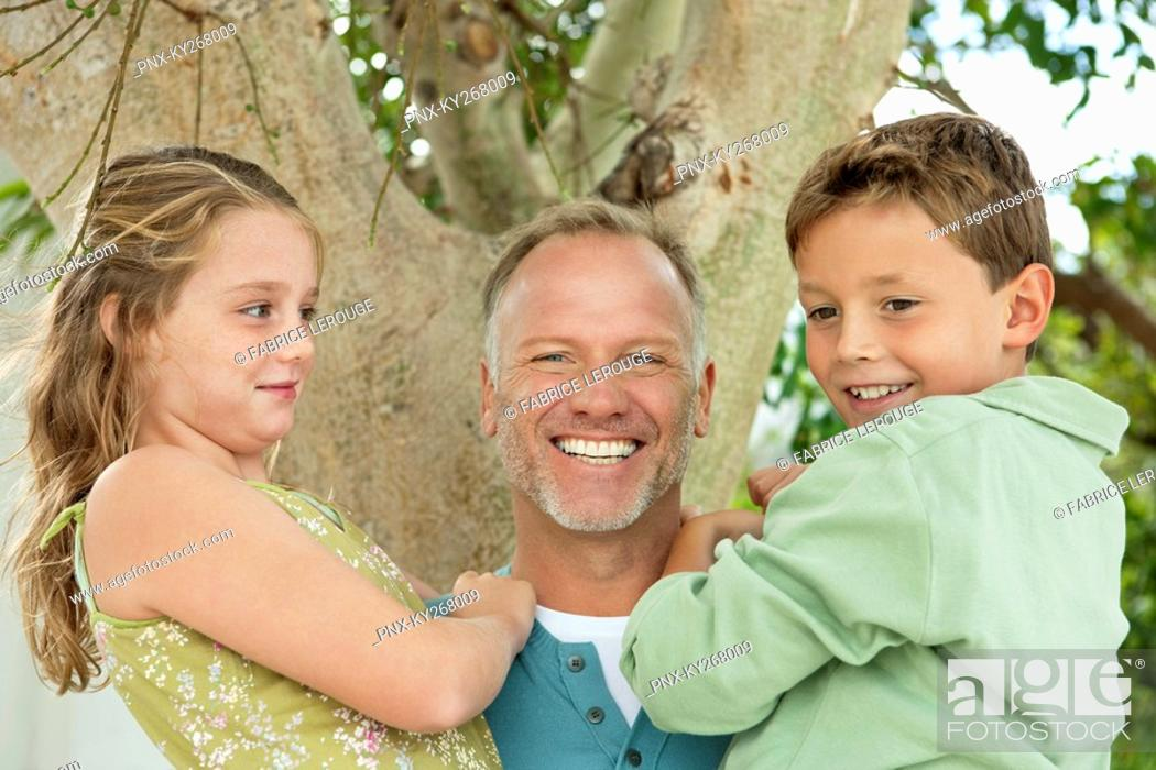 Stock Photo: Man carrying his children.
