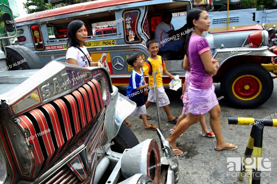 Stock Photo: Filipino people walk trough jeepneys, the most popular transportation vehichle in the philippines  Mandaluyong City  Metro Manila  Philippines.
