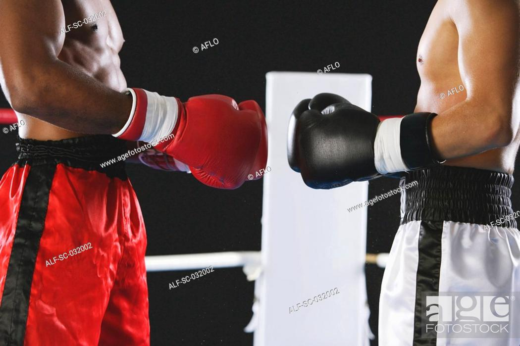 Stock Photo: Two boxers wearing Boxing gloves.