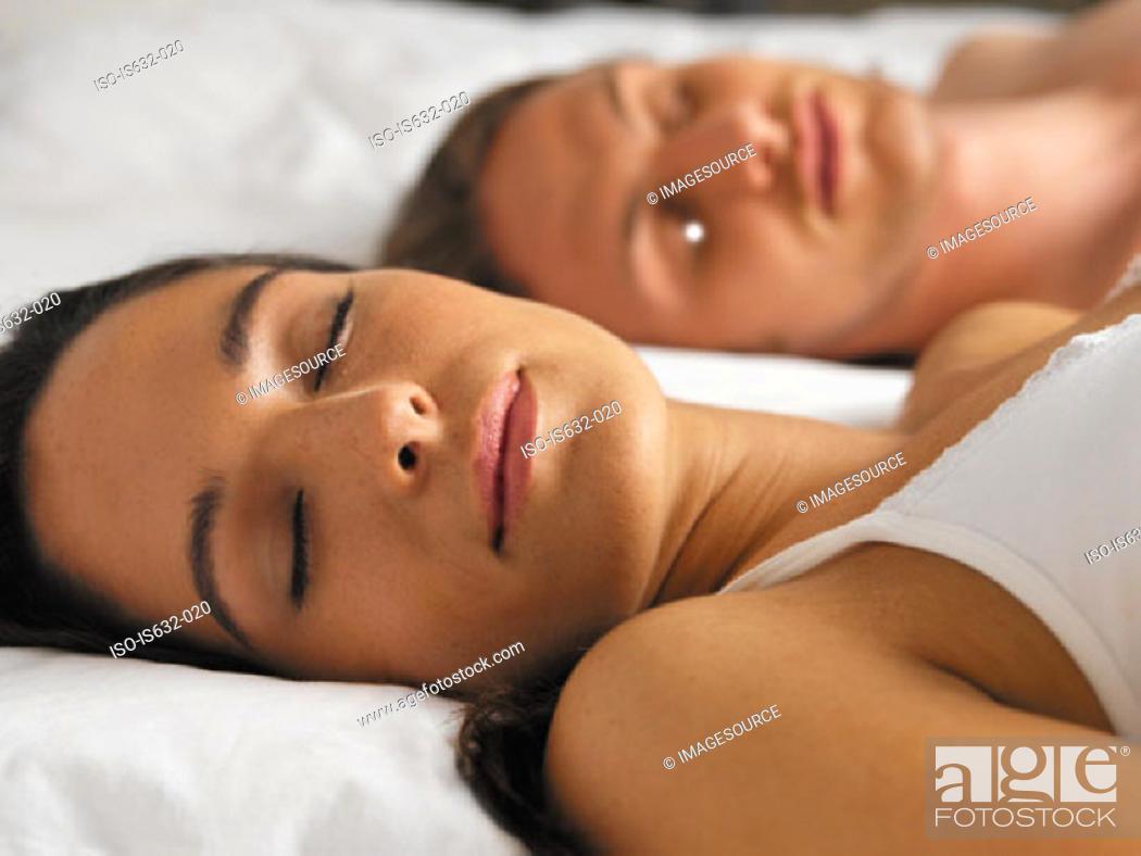 Stock Photo: Young couple sleeping.