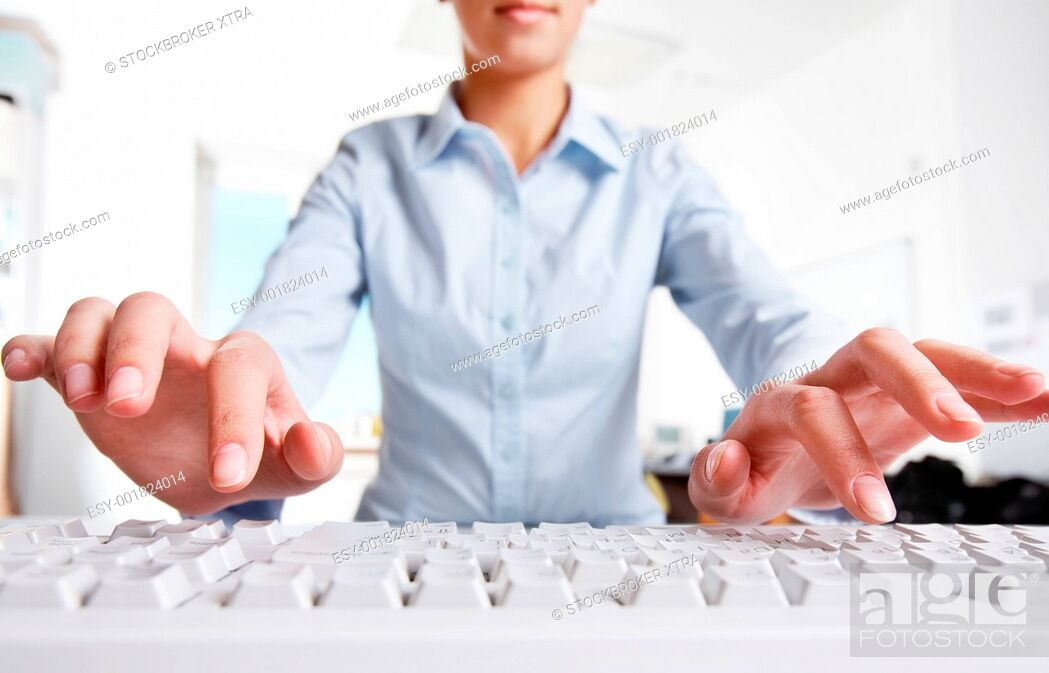 Stock Photo: Photo of woman's hands over keyboard in the office.