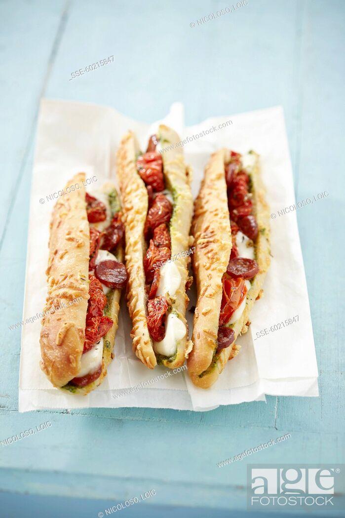 Stock Photo: Pesto, chorizo and sun-dried tomato sandwiches.