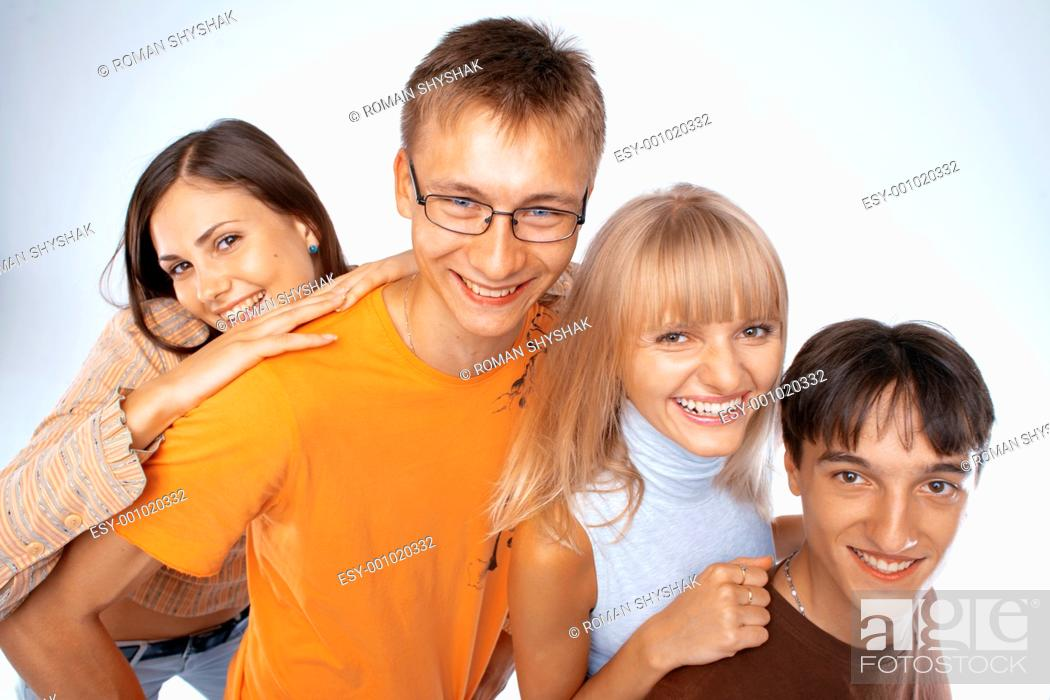 Stock Photo: Young friends laughing together standing in a row.