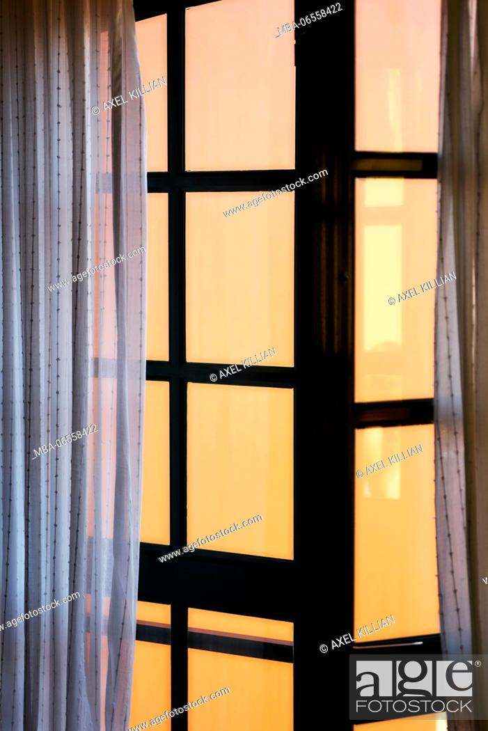 Stock Photo: View from the window with open curtain to a wall of a house.