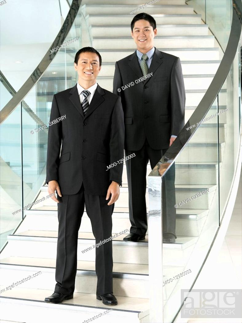 Stock Photo: Confident Businessmen standing on staircase.