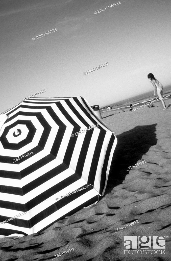 Stock Photo: parasol on the beach of Barcelona.