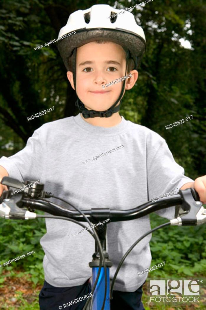 Stock Photo: Boy wearing a bicycle helmet.