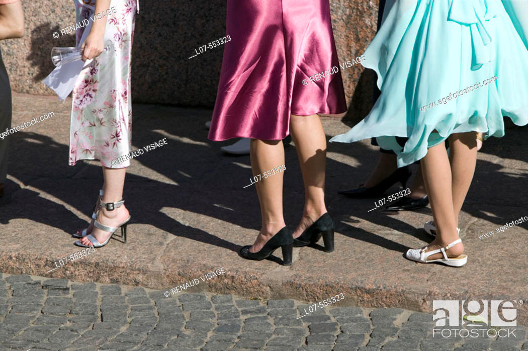 Stock Photo: Women legs in a wedding party. St Petersburg. Russia.