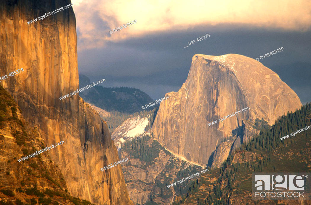 Stock Photo: Late afternoon light on Half Dome and El Capitan under storm clouds, Yosemite Valley, Yosemite National Park, California.