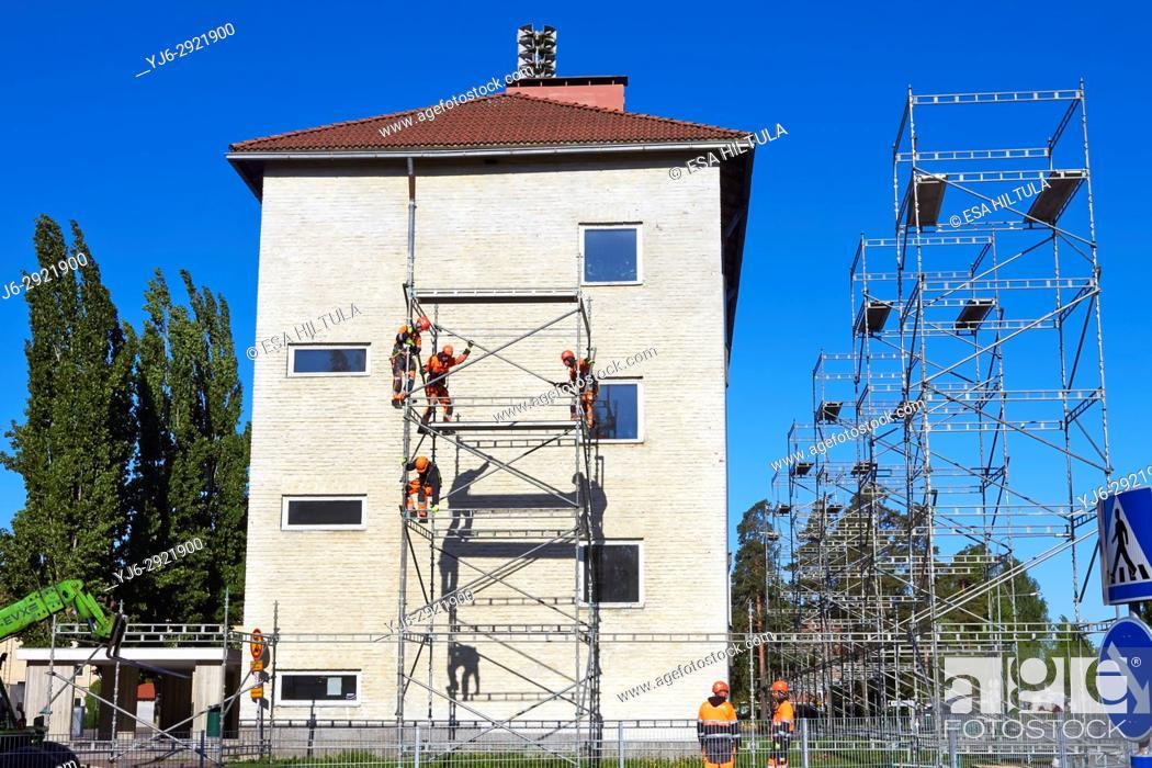 Stock Photo: Men building scaffolding, Finland.