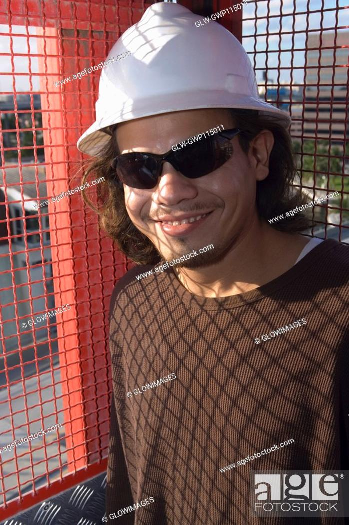 Stock Photo: Close-up of a male construction worker smiling.