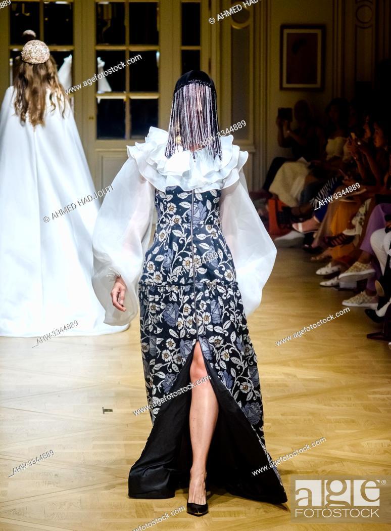 Stock Photo: PARIS, FRANCE - June 30 : A model walks the runway during the Arunaz De Nazym Karpykova Show As part of the Oriental Fashion Show during the Paris Fashion Week.