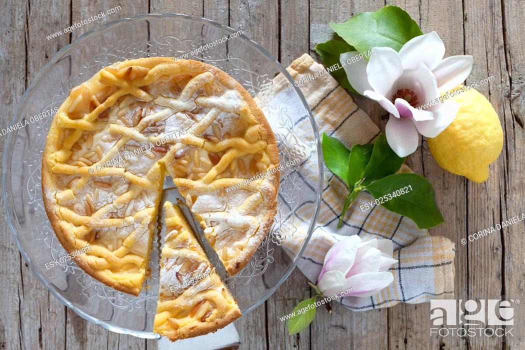 Stock Photo: Slice of grandmas cake, typical cake from Tuscany, Italy, made with shortbread pastry, ricotta cheese and pine nuts.